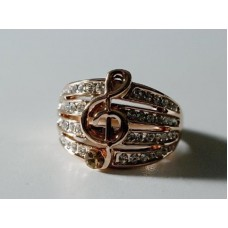 Ring with rose gold finish, G clef, crystals