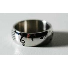 Steel ring. Notes and musical symbols