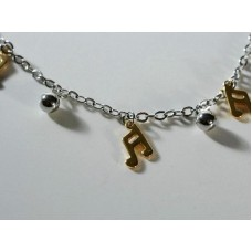 Steel bracelet: gold-colored tied notes