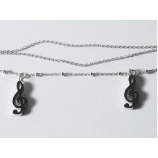 Bracelet in steel: chains and G clefs