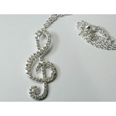 Necklace with large G clef and crystals