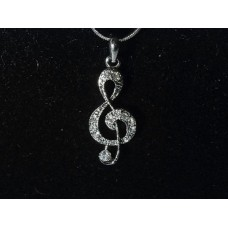 Necklace with pendant G clef and crystals