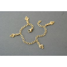 Gold-colored steel bracelet. Bright and luminous G clefs