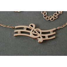 Necklace with G clef pendant on the wave with crystals